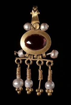 1st-2nd c. Parthian, Seleucia gold, garnet, and pearl earring (1 7/16 x 1 1/8 x 1/2) - Cleveland Museum of Art 1933.193