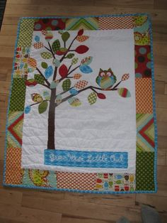"""OWL QUILT. Another one of my original Owl designed quilts....""""Grow Wise little Owl"""" including Heather Bailey's Pop Garden fabric, some Amy Butler and Michael Miller, Ann Kelle Owls---It's entirely backed in Owl print flannel.  Look up Barabooboo on Etsy if you want to order a custom made one in YOUR colour scheme.  www.barabooboo.etsy.com  #owl #quilt #baby #tree #woodland"""