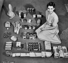 Atlanta housewife Ann Cox Williams poses with the $12.50 worth of groceries that in 1947 fed her family of four for a week