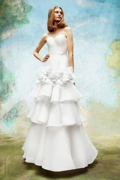Tiered wedding gown by Viktor & Rolf  | Pin discovered by Kelly's Closet bridal boutique in Atlanta, Georgia