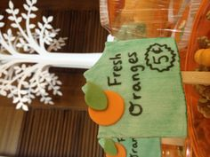 Candy plaques on sticks for orange party