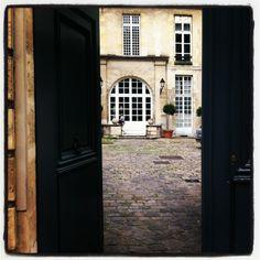 Paris. Cobblestone courtyard. Love.