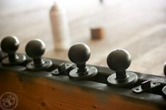 Fastest way to paint doorknobs -5 quick steps which is this is the easiest and fastest way to paint dated gold doorknobs.  Use two 2×4 wood boards to hold each of the door knobs and locks.