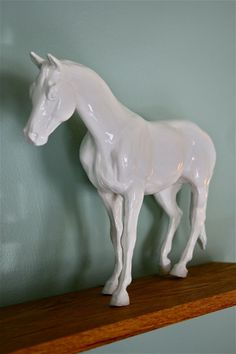 Spray painted plastic horse looks like a ceramic piece.