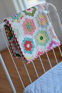 Flower Girl        hexie flower garden quilt by ahappydance. Quilts