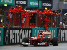 Alonso crossing finish line P1 Malaysia GP
