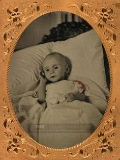 Dead child with open eyes. Tintype, circa 1862, post mortem photographs were a regular occurrence