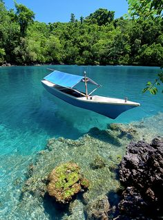 Beautiful clear waters in Ternate Island, North Maluku, Indonesia by (Abdul Azis).