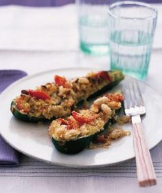 Instead of traditional breadcrumbs, use a flavorful quinoa mixture with beans and tomatoes to fill the hollowed-out zucchini.