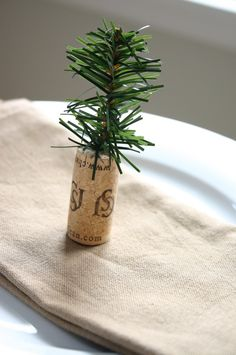 tiny tree out of clipped garland and a cork... would be cute for place settings at a Christmas dinner or for decor