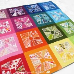 Ticker Tape quilt made in rainbow hues.