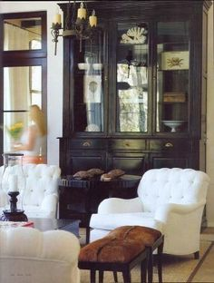 Black hutch, hide stools, classic arm chairs