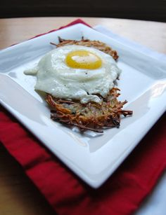 Oven baked potato pancakes with sunny side up eggs