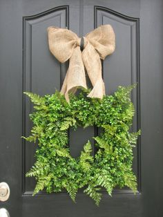 Black door + burlap + fern.  Love.