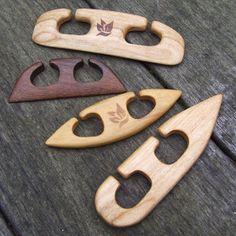 Hand carved weaving shuttles.