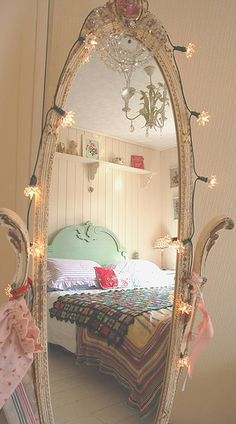 I have a mirror very similar to this! It was my grandma's. Now to decide if I want to refinish it in white before stringing the lights on it!