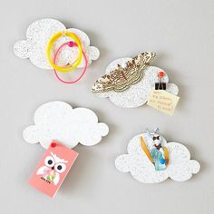 A cute way to hang art in a playroom.  Buy 10 sets of these to create a cloud wall! #littlenest #pinparty