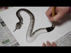 How to paint a snake with one stroke - an easy technique that can be altered for different purposes. (I think the painter is using glossy paper on this one but the basic idea works well with oil paints, too..)