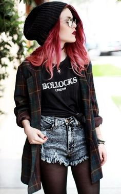 90s grunge-inspired: black tee shirt and beanie, oversized plaid button-down, acid wash cut-offs, black tights