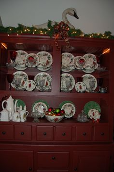 Lenox Winter Greetings dishes in an original hutch, painted with Old Village New England Red paint.