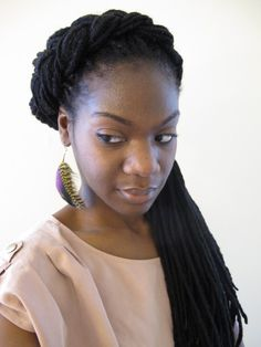 Genie Locs and Yarn Braids  Utilizes acrylic knitting yarn wrapped around a braid or twist (or braided/twisted in with natural hair to extend length) and produces a matte or dull finish that resembles loced Type 4 hair.