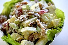 First presented at the Waldorf Astoria Hotel in 1893, this all-American Waldorf salad recipe includes chopped apples, celery, grapes, and toasted walnuts in a mayonnaise dressing.