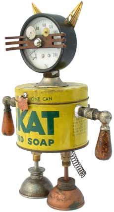 """Name: Goodbye Kitty  D.O.B.: 2/28/09  Height: 9.5""""  Principal Components: Pressure gauge, soap can, drawer pull, watch parts, oil cans"""