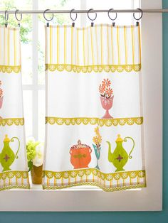 Dress your windows quickly and smartly with tea towels turned into café curtains. Simply clip drapery rings to the top edges of the towels; thread the rings onto a curtain rod. You'll want the curtains to hang down to the windowsill, so mount the rod accordingly. If you have a double-hung window, position the rod so the top edge of the curtain lines up with the sash.       If necessary trim the towels to length and hem using a sewing machine or iron-on fusible webbing for a no-sew option.