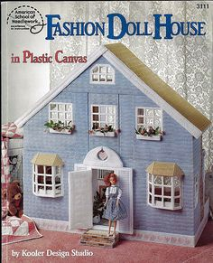 A Barbie house in plastic canvas