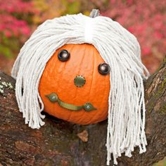 Give your pumpkin extra personality by using a mop as hair, and cabinet pulls as eyes, nose, and a mouth!