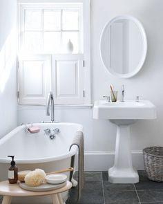 Lovely simple, white bathroom.