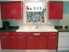 I Love the red cabinets. The paint color is called aquatint by Sherwin Williams.