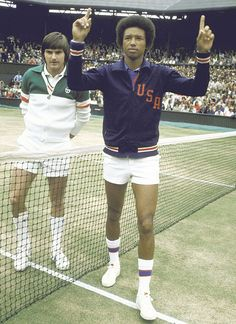 Arthur Ashe acknowledges the crowd after defeating Jimmy Connors in four sets at the 1975 Wimbledon finals.Ashe, 35, was the underdog against 22-year-old Connors but kept the youngster off guard with a mix of pace and angles. The victory was Ashe's first Wimbledon title and third Grand Slam overall. More importantly, the victory made him the first black male player to win at Wimbledon. (Tony Triolo/SI)
