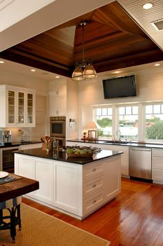 Wood ceiling and stunning floor in kitchen