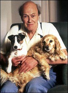 A picture of Roald Dahl with his dogs.