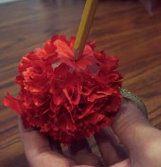 Use a pencil to poke scrap fabric into a styrofoam ball (a little glue might help) to make Christmas ornament