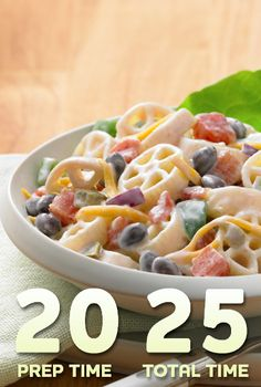 Southwest Pasta Salad...enjoy this twist on pasta salad warm or cold! Easily prepare this Southwest pasta salad for a picnic or family barbecue with Ranch Style black beans, diced tomatoes and Cheddar cheese!