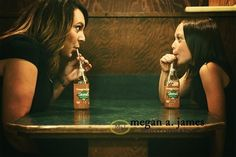 In a corner booth. | 31 Impossibly Sweet Mother-Daughter Photo Ideas