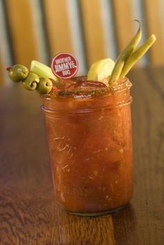 Mason jar bloody mary bar with fixings. Could have fun with quotes on cocktail stirrers.