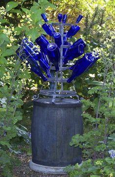 Glass bottle tree | ... Corvallis turned an old bottle rack into a bottle tree for the garden