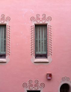 windows of a house where Gaudi lived in Barcelona