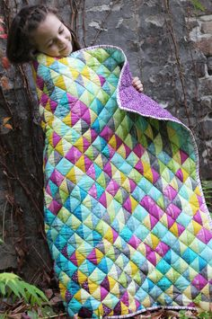 Half square triangles quilt by Katarina Roccella featuring Art Gallery fabrics