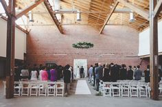 so simply gorgeous, a stunning ceremony setup | Los Angeles Warehouse Wedding: Stephanie + Scott