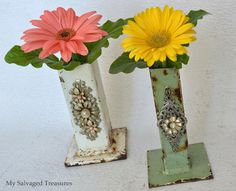 Vases made from rusty industrial pole legs.