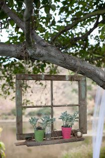 Upcycle an old window frame to hang from a tree with some rope or chain ... This gorgeous garden art creates an outdoor 'room with a view' and the bonus of a practical outdoor window box ... <3 this idea! For more DIY repurposed garden projects see http://themicrogardener.com/diy-repurposed-garden-projects/ | The Micro Gardener