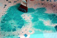 Paper doily as a stencil ~ Mod Podge Rocks!