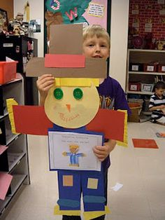Kindergarten Fall Fun! Scarecrow art project with booklet on tummy of scarecrow.