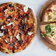 Sausage-and-Olive Pizza with Capers and Pecorino Sardo // More Recipes with Olives: http://www.foodandwine.com/slideshows/olives #foodandwine