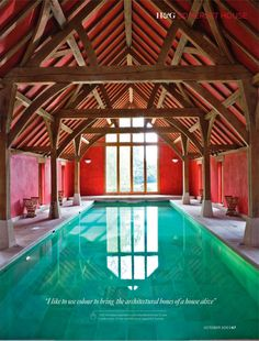 giant swimming pool in an old barn.  I love the rafters, and the red walls with the turquoise pool.  I will have this