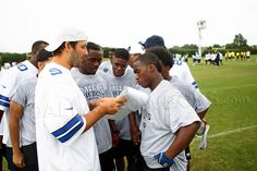 Tony Romo helping CowboysU participants.